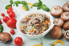 Clear mushroom soup. Clear portabello mushroom, vegetable and noodle soup Stock Photography