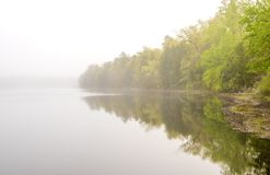 Clear my mind. Peaceful morning on the lake at Wharton State Forest, New Jersey. Beautiful foggy scenery Stock Image