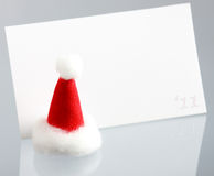 Clear New Year card and hat of Santa Claus Stock Photos