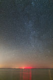 Clear night over the lake. Milky Way across the sky Royalty Free Stock Images