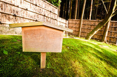Clear notice board on grass field Royalty Free Stock Photo