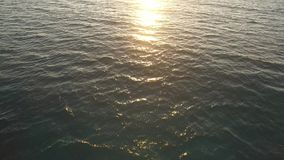 Clear ocean water sunset reflection stock footage