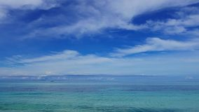 Clear Ocean Waters. Clear, calm ocean waters under the vivid blue sky. Shot in San Juan, Siquijor Island stock video