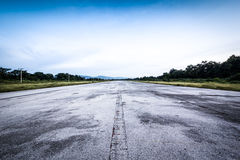 Clear old road/runway and cloudy blue sky Stock Image