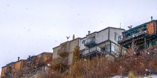 Clear Panorama Homes on snowy mountain against bright sky royalty free stock image