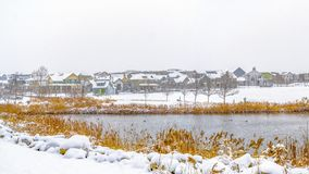 Clear Panorama Panorama of a lake in Daybreak Utah with wooden decks and snowy shore in winter. Distant homes and buildings can be also be seen against the stock photos