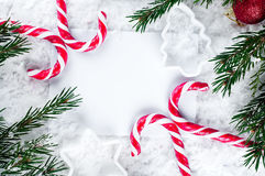 Clear paper laying with candy cane. Stock Image