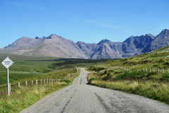 Clear Pathway Between Grass Far from Mountain during Daytime Royalty Free Stock Images
