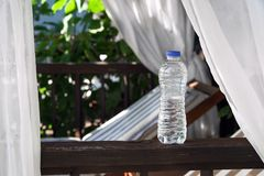 Clear Plastic bottle with water standing  on a terrace Royalty Free Stock Photography