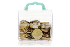 Clear plastic box with coins Royalty Free Stock Images