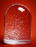 Snow Globe on Red Background Stock Photography