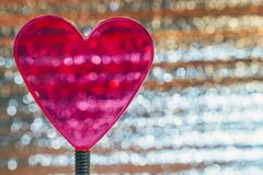 Clear Red Heart On Coil Spring. Metallic Foil Background With Angled Silver Shiny Stripes, Orange Highlights. Valentines Day,. Christmas, New Year Banner stock photo