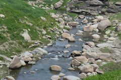 Mountain river stream of water in the rocks. Clear river with rocks. Nature and water royalty free stock photo