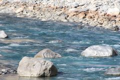 Mountain river stream of water in the rocks. stock photo