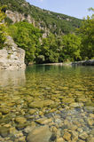 Clear river water. The clear water of Vicos river, Greece Royalty Free Stock Photos