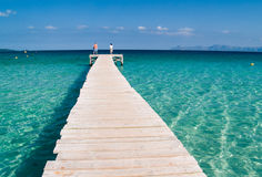 Clear sea and board walk Stock Photo