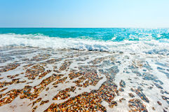 Clear sea water and pebble beach Royalty Free Stock Photo