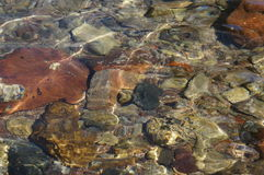 Clear sea water and stones Royalty Free Stock Photos