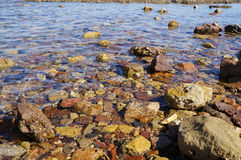 Clear sea water and stones Stock Photos
