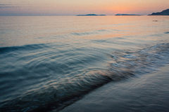Clear sea water surface at the sunset. Dark sunset at the sea. End of the day at he beach. Wavy sea water surface. Wildlife of the sea. Horizon line at the royalty free stock photos