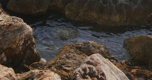 Clear sea waters in the rocks. Calm clear Mediterranean sea waters in the rocks stock footage