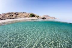 Clear Seas bathe an Island in Komodo National Park Stock Photo