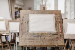 Sheet of paper on easel stock photo