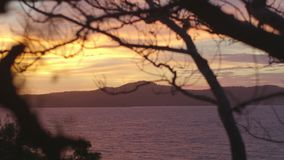 Sunset view of sea with hills. A clear shot during sunset with sea and hills stock video footage