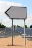 Clear signpost. Empty guide sign standing at an intersection Royalty Free Stock Photography