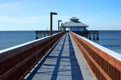 Clear skies over the fishing pier at Times Square in Fort Myers Beach. stock photo