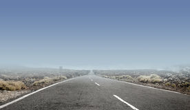 Clear sky above the empty rural road Stock Photography