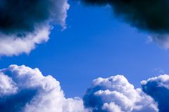 Clear sky between clouds Stock Image