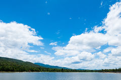 Clear sky with clouds over the lake Stock Photos