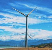 Clear sky and enormous windmills. stock photos