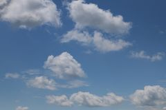 Clear sky with few clouds stock image