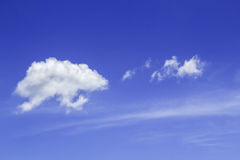 Clear sky and fluffy cloud Stock Images