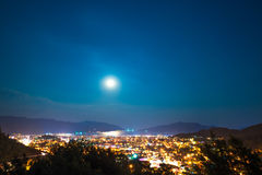 Clear sky and full moon over city. Clear sky and full moon over night city Stock Photography