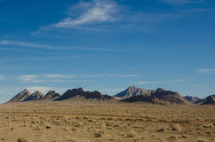 Clear Sky. And a landscape view of desert and mountains Royalty Free Stock Photography