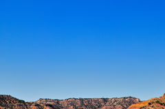 Clear sky over rocks at Palo Duro Canyon, USA. Clear blue sky over rocks at Palo Duro Canyon, Texas, USA Royalty Free Stock Image