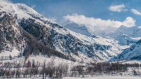 Clear sky`s above wild enormous mountains. On a winters day royalty free stock images