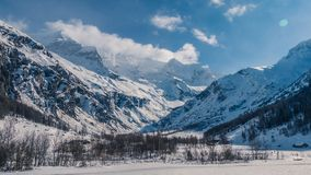 Clear sky`s above wild enormous mountains. On a winters day royalty free stock photos