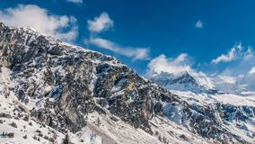 Enormous mountain peaks standing tall. Clear sky`s above wild enormous mountains on a winters day royalty free stock photography