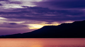 Clear sky sunset over the Lam Ta Klong dam. Stock Photos