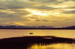 Clear sky sunset over the Lam Ta Klong dam. Royalty Free Stock Photo