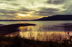Clear sky sunset over the Lam Ta Klong dam. Royalty Free Stock Photos