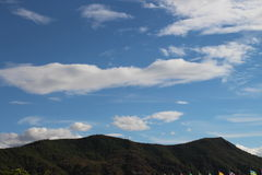 A clear sky,Towering mountains Royalty Free Stock Photo