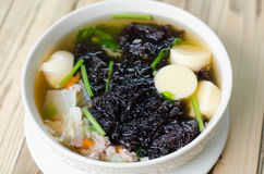 Clear soup with seaweed and minced pork. Thai food royalty free stock image