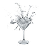 Clear splashes in martini glass.