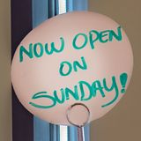 Clear Square Close up view of a handwritten sign that reads Now Open On Sunday royalty free stock images