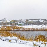 Clear Square Panorama of a lake in Daybreak Utah with wooden decks and snowy shore in winter. Distant homes and buildings can be also be seen against the stock images